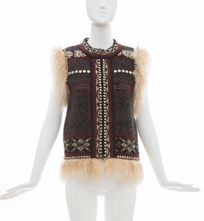Jean Paul Gaultier, Autumn-Winter 2010 wool-blend vest with Mongolian fur trim throughout, brass stud embellishments at trim, pattern throughout and concealed two-way zip closure at center front.