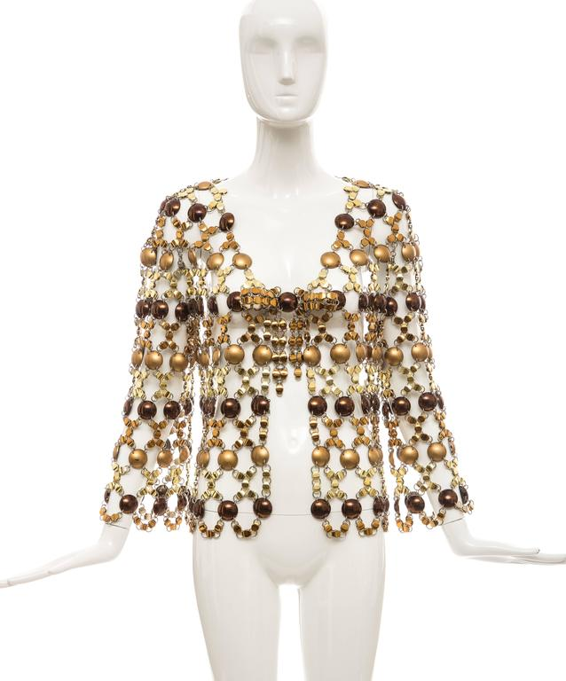 Paco Rabanne, circa 1970's, chain mail top consisting of bronze and copper plastic circular disks with bronze and gold metal links and numbered fabric tag.  Shoulder: 17, Bust: 36, Length: 16, Waist: 36