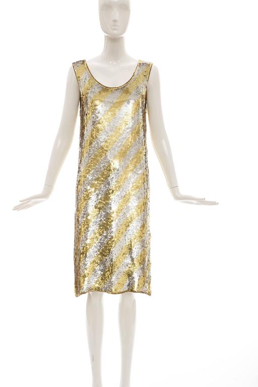 Christian Dior by Marc Bohan, circa 1970's, sleeveless shift dress with diagonal stripe embroidery of gold and silver sequins, side zip and fully lined.  Bust: 36, Waist: 34, Length: 40.5