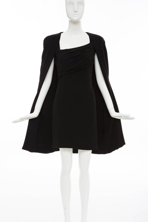 Tom Ford, Autumn-Winter 2012, silk evening dress ensemble. Cape features tonal stitching throughout and open front. Dress features cap sleeves,  asymmetrical pleating at bust, concealed zip closure at back and fully lined.  Fabric: 97% Silk, 35