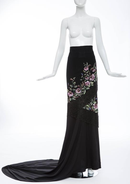 Givenchy Haute Couture by Alexander McQueen, Autumn-Winter 1998 black skirt with satin waistband, boning at waist, netted tulle overlay, floral beaded pattern throughout, asymmetrical beaded fringe trim, train at back and side concealed zip and snap