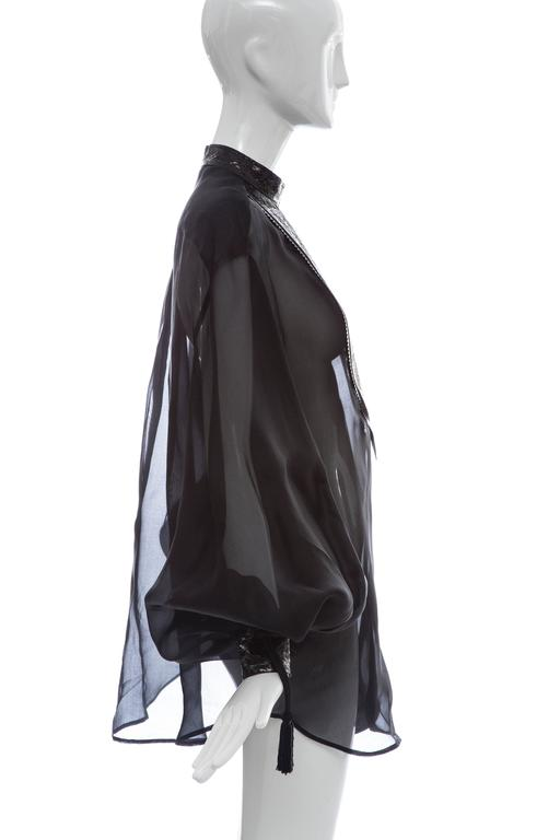 """Christian Dior, circa 1980's numbered black silk organza blouse featuring stand collar , bishop sleeves with tassel and bead embellishments, embossed leather accents throughout and concealed snap closures at front.  Bust: 46"""", Waist: 48"""", Length:"""