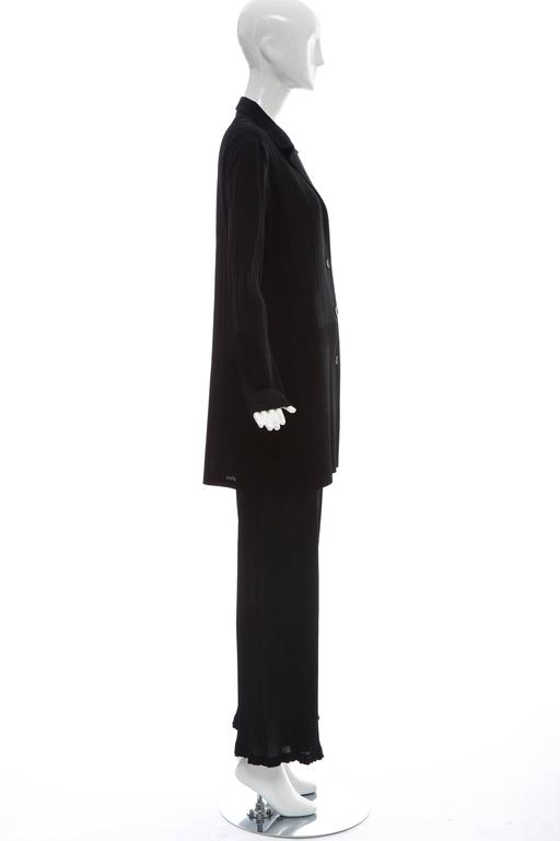 Issey Miyake, White Label, black pleated polyester button front elastic waist pant suit.  Japan: Size 4  Jacket: Bust 48, Waist 44, Length 33.5 Pant: Waist 34, Hips 48, Length 40