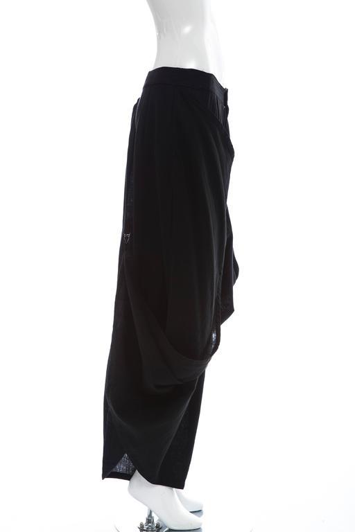Kansai Yamamoto, circa 1980's black linen cotton, zip and button front harem pants with suspender clips.  Japan 26  Waist: 30, Length 38