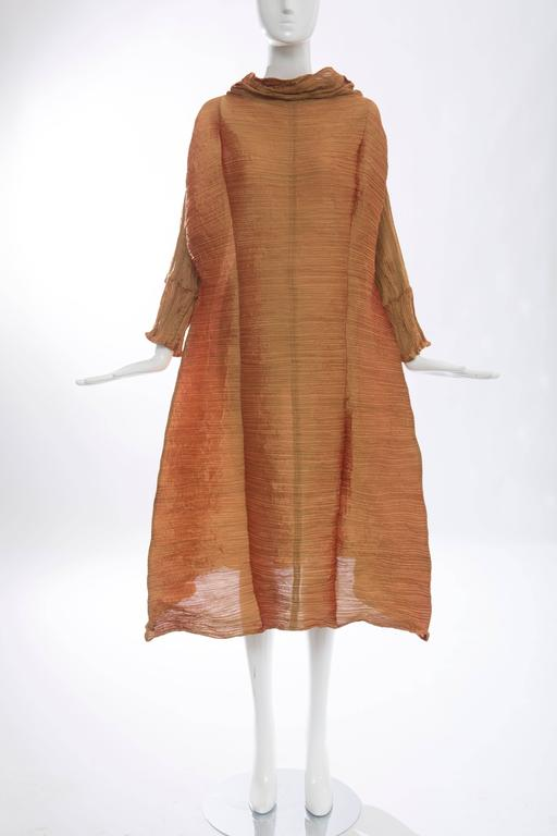 Issey Miyake, Autumn-Winter 1992, A-Line long sleeve polyester pleated Tidal Wave dress with funnel neckline and pleated scarf.  The dress is in the collection of the Met Museum - Accession Number:2005.323.7  Bust: 32