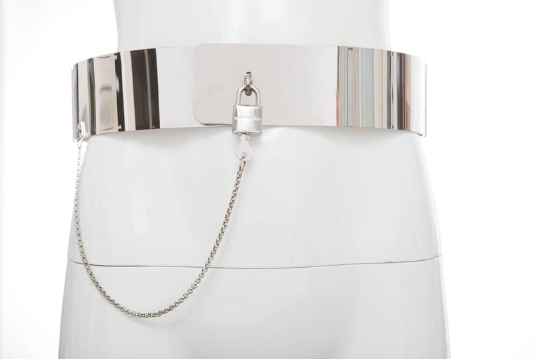 Dolce & Gabbana, Autumn - Winter 2007 metallic silver-tone hardware belt with hinges at sides and padlock and key closure at front.  Small Length Min: 29 Length Max: 30 Width: 2.25