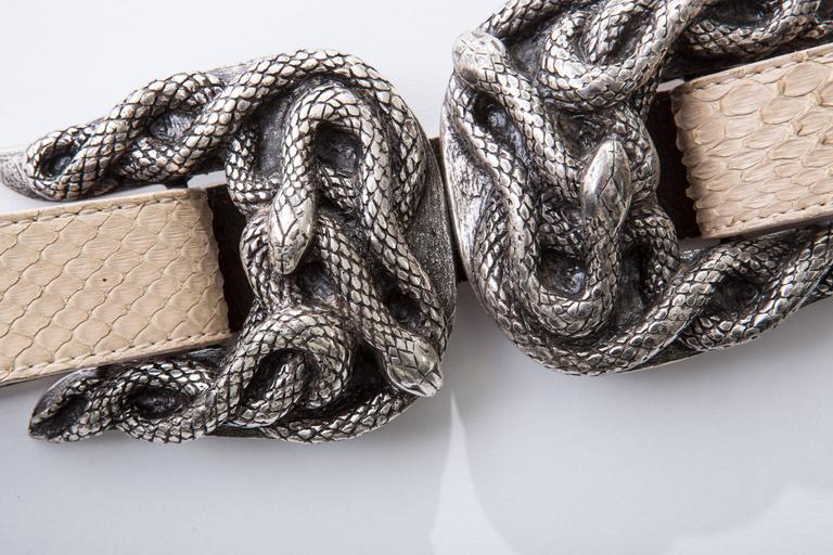 Roberto Cavalli adjustable python belt with snake buckle.  Size Large  Adjustable up to 33 inch.