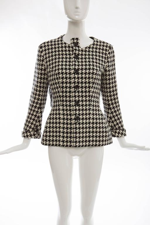 Yohji Yamamoto, Autumn-Winter 2003 wool jacket with Houndstooth pattern throughout, leather trim, fringe trim at back and front button closures.   Designer size 2. Bust: 42 Waist: 40 Shoulder: 17 Length: 26 Sleeve: 29