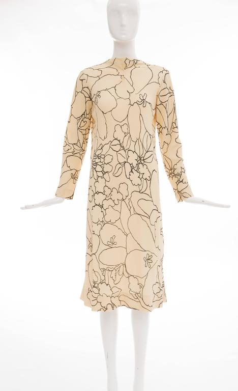 Pauline Trigere, circa 1980's cream and black floral silk crepe long sleeve dress with detached scarf and sash, back zip and fully lined.  Bust: 40, Waist: 40, Hips: 51, Length 44