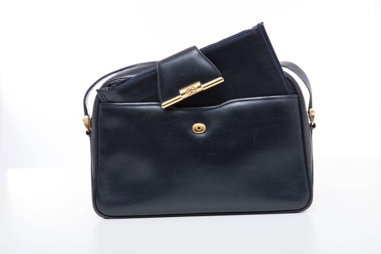 Gucci, circa 1970's navy blue leather cross body bag with snap front detachable wallet, YKK zipper, interior zip pocket.  Serial Number 46-01-4160
