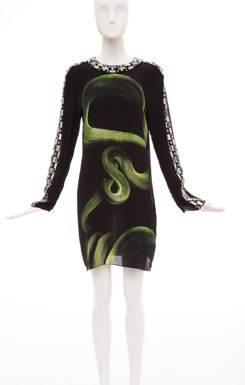 Alber Elbaz for Lanvin, Spring-Summer 2012 black silk shift dress with python print, crystal embellishments at sleeves and dual snap closures at back.  FR. 40 US. 8  Bust 40, Waist 38, Hips 42, Length 36