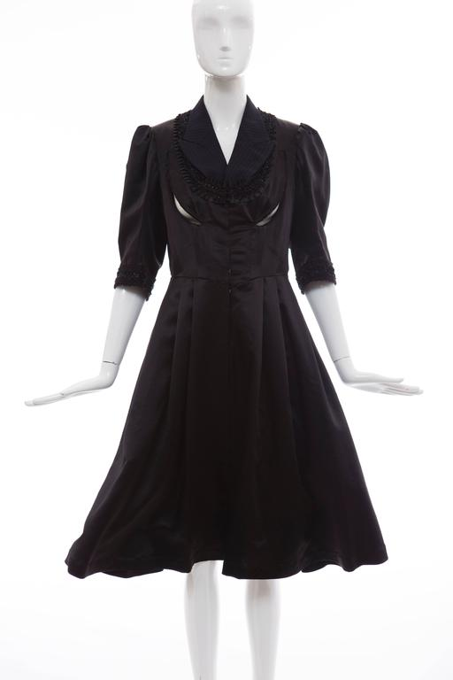 Comme des Garçons, Fall 2006 navy black midi wool silk satin dress with peak lapels, three-quarter length sleeves, embroidered and ruffle trim at neckline and sleeve cuffs, dual pockets at sides and hook closures at front.  Japan: Small  Bust 34