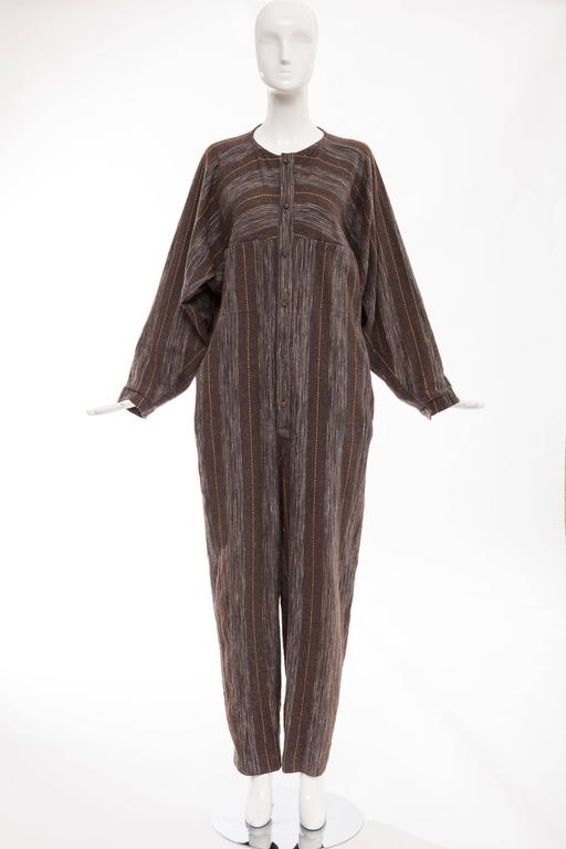 Issey Miyake Plantation, circa 1980's blue chocolate brown striped woven medium weight cotton jumpsuit with front wood button closure and two front pockets.  Japan: Medium  Bust 54