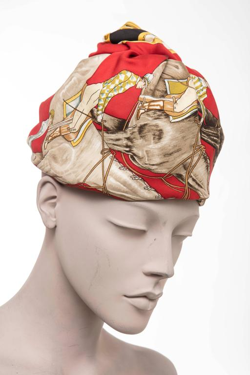 Hermes, circa 1970's equestrian printed silk turban with netted interior and grosgrain headband.  Circumference: 23 inches