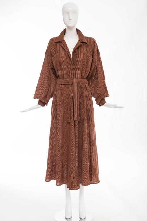Norma Kamali, circa 1980's terracotta cotton gauze windowpane check dress, removable velcro shoulder pads, two front pockets with self belt and side zip.  US. 6  Bust 36, Waist 25, Hips 56, Length 51