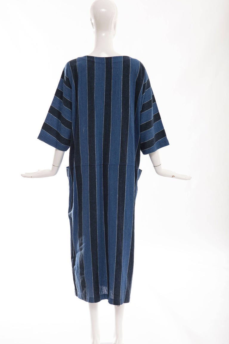 issey Miyake Plantation, circa 1980's blue striped woven cotton dress with boat neck and two deep front pockets.  Japan: Medium  Bust 52, Waist 46, Hips 46, Length 49