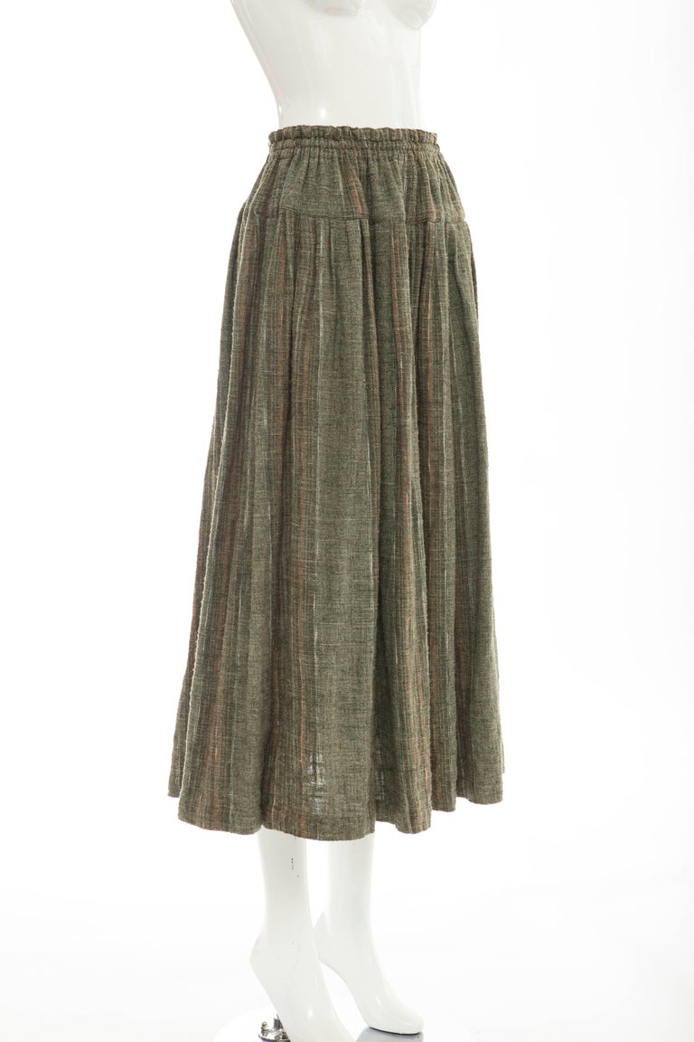 Issey Miyake Plantation, circa 1980's olive green woven cotton skirt with gathered elastic waist and two front pockets.  Japan: Medium  Waist 32, Hips 78, Length 36