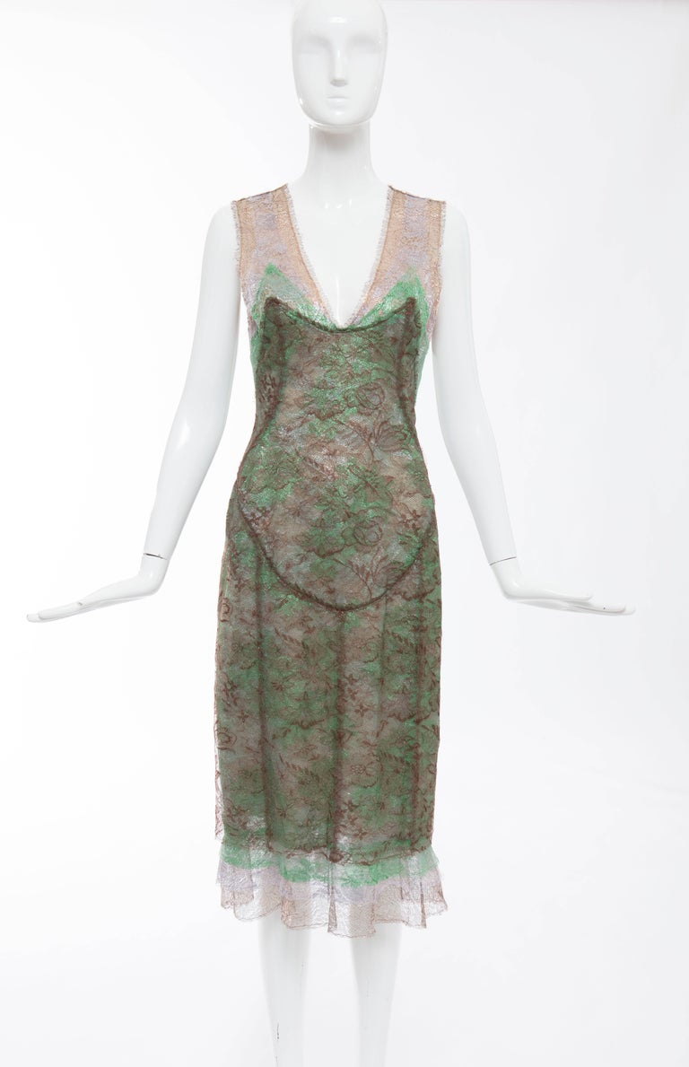 Zac Posen, Fall 2004 sleeveless layered metallic lace evening dress with covered button back closure and fully lined in silk.   The dress was on the cover of Oprah magazine, December 2004.  US. 6  Bust 32, Waist 28, Hips 36, Length 45
