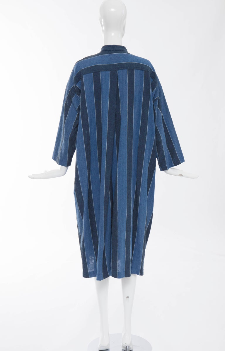 Issey Miyake Plantation, circa 1980's blue striped button front woven cotton dress with three front pockets.  Japan: Small  Bust 54, Waist 54, Hips 54, Length 46, Sleeve 16