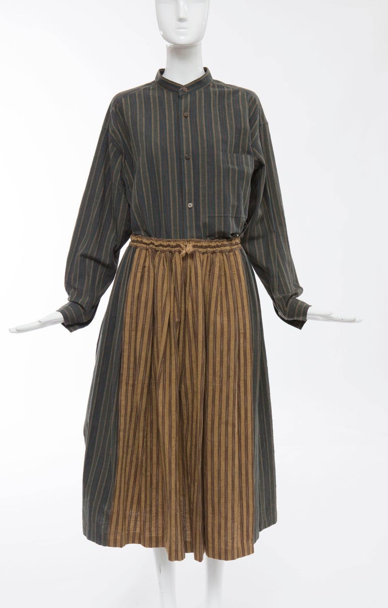 Issey Miyake Plantation, circa 1980's striped woven cotton skirt suit. Button front long sleeve shirt with front pocket, elastic waist skirt with two front pockets.  Shirt Japan: Size Medium Bust 49, Waist 48, Sleeve 21, Length 30  Skirt Japan: