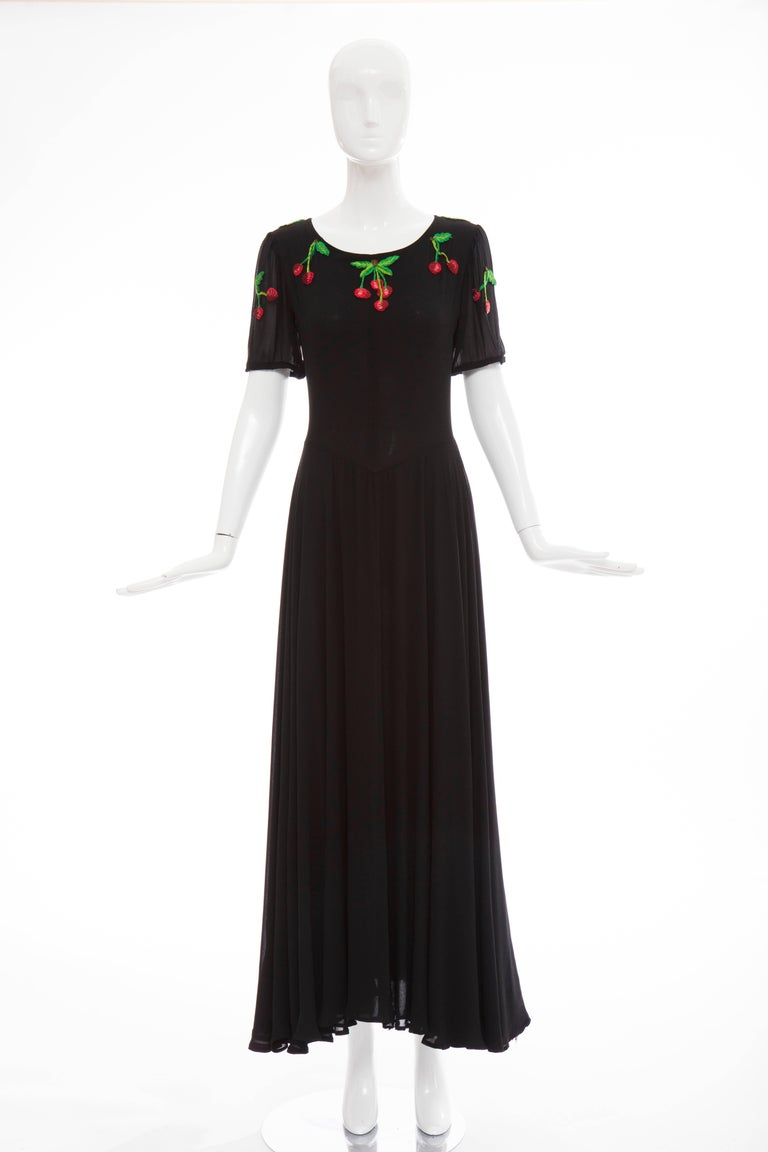 Valentino, Circa 1970's black rayon crepe hand embroidered cherries evening dress with jewel neckline, back zip and fully lined.  Label: Size 8, Modern size   Bust 31, Waist 26, Hips 74, Length 56