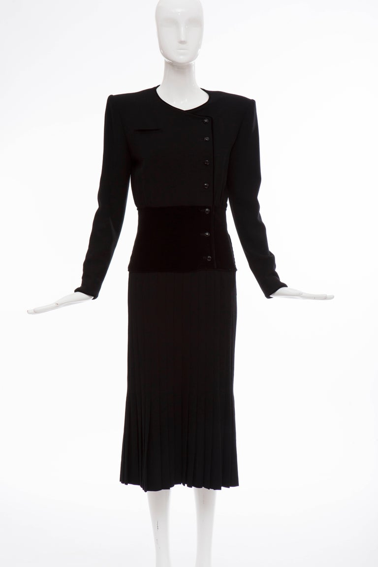 Valentino, Circa 1980's black wool crepe, button front, faux pocket and pleated skirt evening dress with black velvet waistline and lined in silk.  US. 6  Bust 37, Waist 27, Hips 34, Sleeve 23.5, Length 47.5