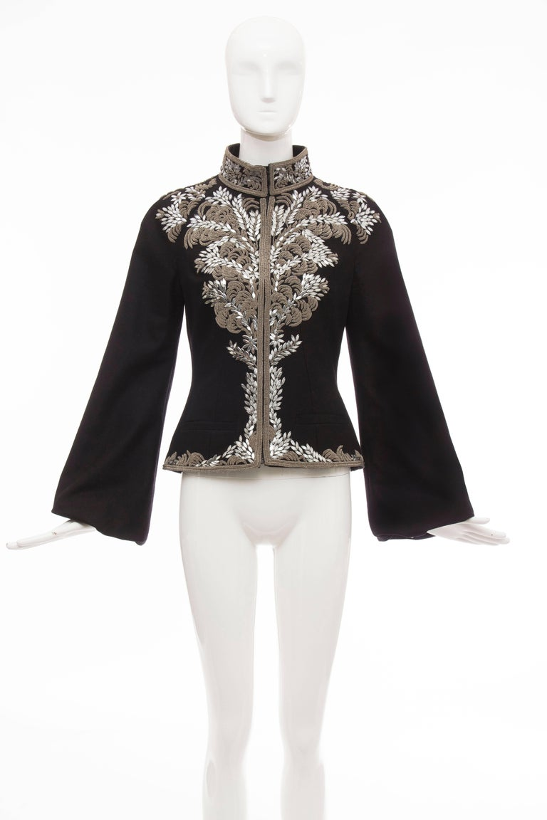 Alexander McQueen, Circa 2004 black zip front wool jacket embroidered with silver purl wire and elliptical sequined paillettes, mock collar, long bishop sleeves, dual welt pockets and fully lined.  IT. 40 US. 4  Bust: 35, Waist 32, Shoulder 15.5,