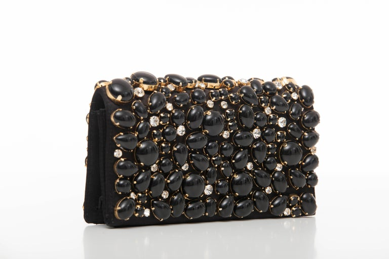 Prada, Spring-Summer 2011, black silk satin Raso Pietre evening clutch with gold-tone hardware, cabochon and prong set crystal embellishments throughout, card slot at interior and magnetic snap closure at front flap.   Height: 4.5, Width 7.5, Depth