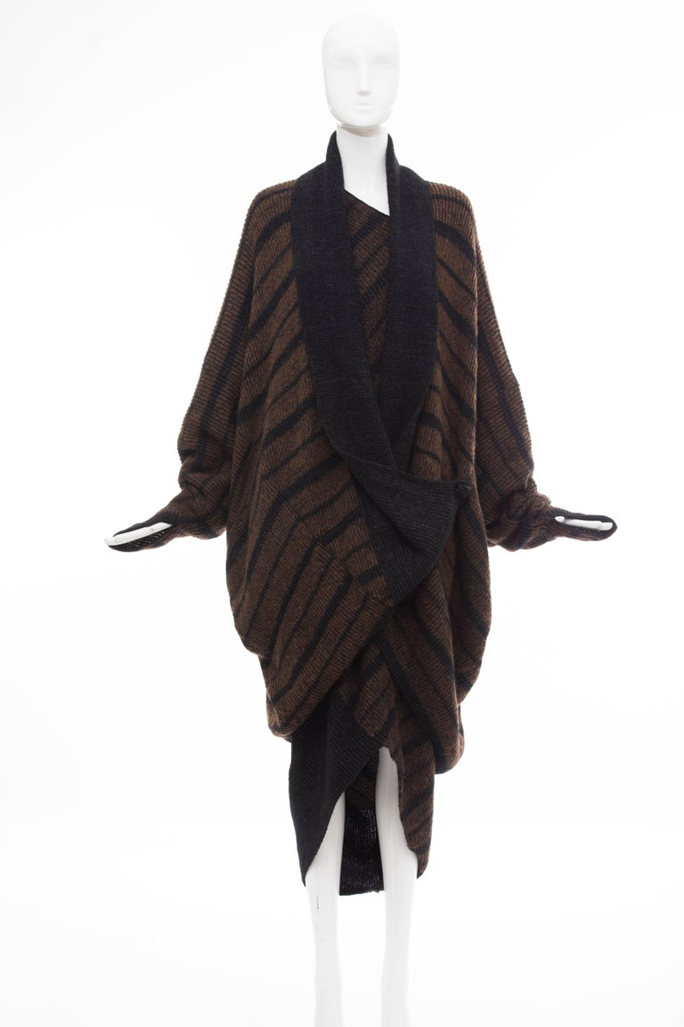 Issey Miyake, Circa 1970's sweater dress and cocoon cardigan ensemble. Wool long sleeve sweater dress with geometric neckline, striped pattern, tapered hem and tonal stitching throughout with long sleeve cocoon cardigan with striped pattern,