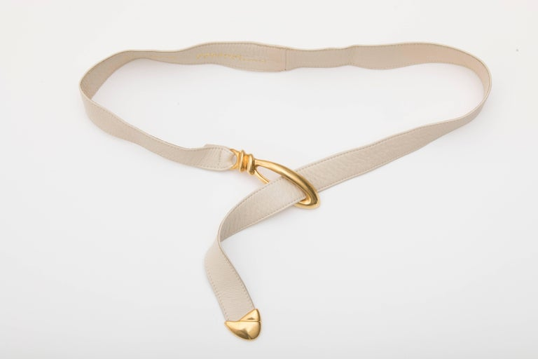 Donna Karan, circa 1980's cream leather belt with Robert Lee Morris buckle.  Size: Petite-Small   Length including Buckle 41 inches