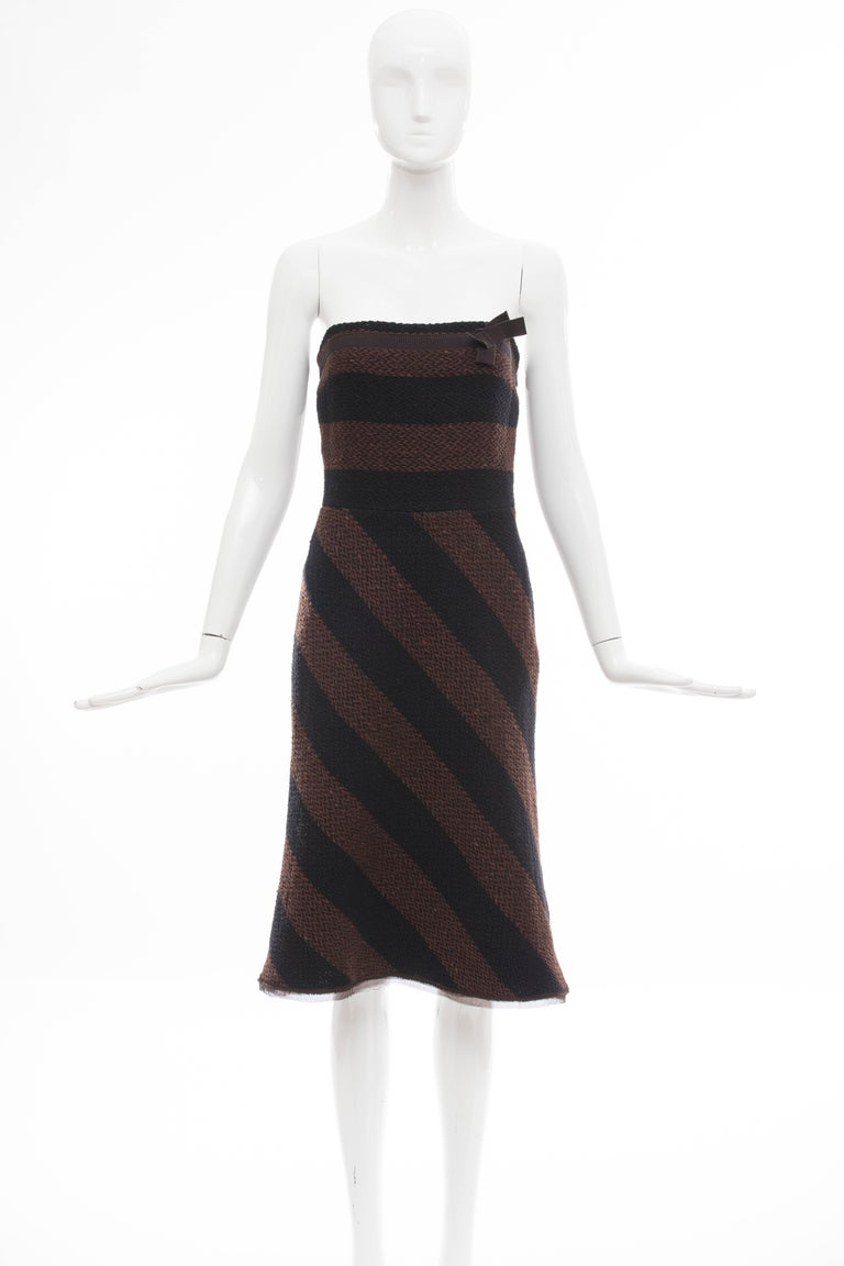 Prada, Autumn-Winter 2000 Runway Look 10, brown and navy blue virgin wool tweed strapless dress with striped patterned throughout, grosgrain trim and bow accent at bodice and side zip closure.  IT. 42 US. 6  Bust: 32, Waist 27, Hip 36. Length 35