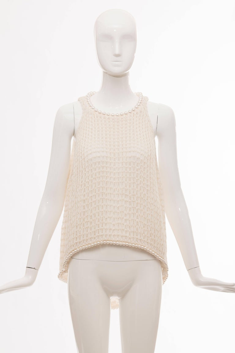 Chanel, Spring 2009 cream silk blend, open knit, sleeveless top with crew neck, faux pearl embellishments, slit at back and single button closure at nape.  FR. 42 US. 10  Bust: 37, Waist 42, Length 29.5