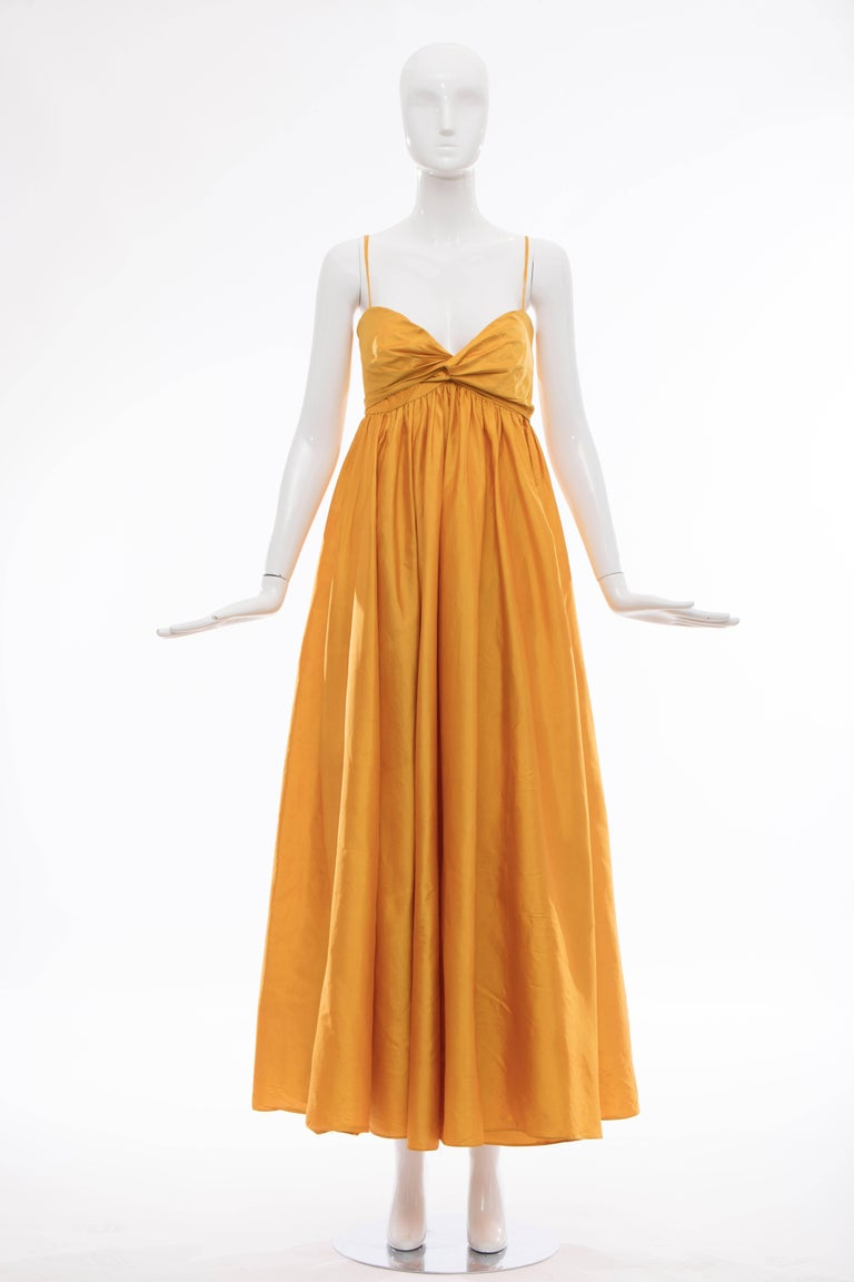 Donna Karan, Circa 1980's silk marigold evening dress with spaghetti straps, sweetheart neckline, two front pockets and concealed back zip.  US. 10 Bust: 32, Waist 30, Hip 44, Length 58