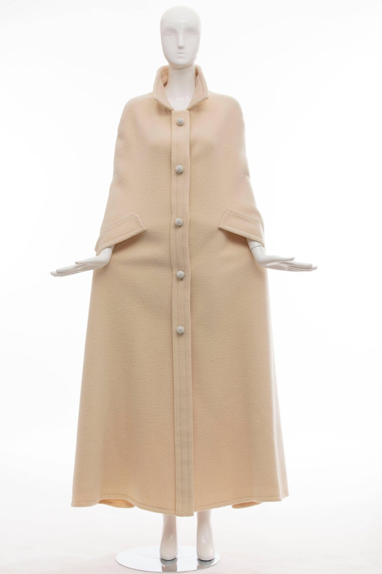 Christian Dior Haute Couture by Marc Bohan Autumn-Winter 1966 cream wool cape with pointed collar, dual slits at sides and diamante embellished contrast snap closure at center front.  No Size Label  Length 57