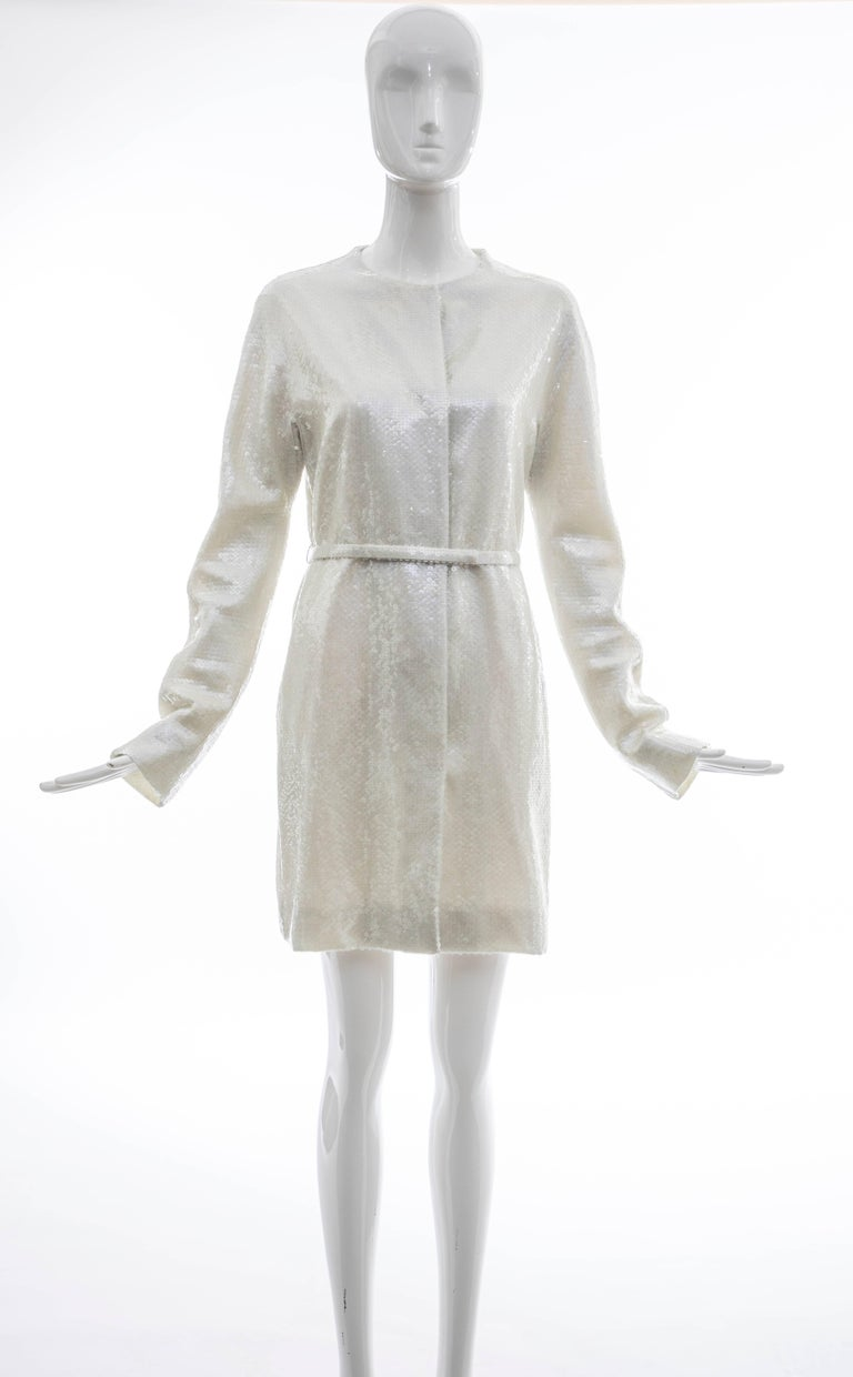 Raf Simons for Jil Sander, Spring 2007 runway (Look 46) pearlescent sequin button front evening lightweight coat with dual front pockets, self belt and fully lined in silk.  Bust 36, Waist 33, Hips 38, Length 35, Shoulder 16, Sleeve 37  EU. 38 US. 6
