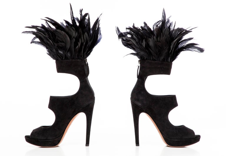 Azzedine Alaïa, Fall 2010 black suede peep-toe platform pumps with cutouts throughout, covered heels and feather trim at uppers. Includes box and dust bag.   IT. 37 Us. 7  Heels: 5.25, Platforms: 1