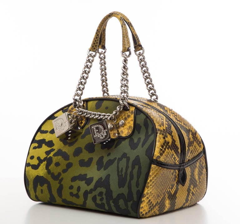 John Galliano for Christian Dior, Autumn-Winter 2004 leopard printed canvas handbag with silver-tone hardware, dual chain-link top handles, python and black patent leather trim, crystal embellished logo dice adornments, black Diorissimo woven