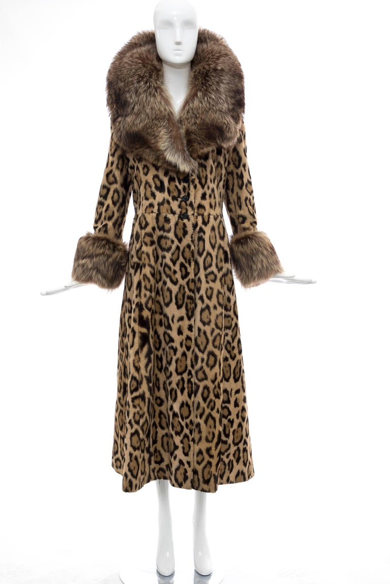 Goldring's Couture, Circa: 1970's faux leopard button front maxicoat with dramatic racoon fur collar and cuffs, two front pockets and fully lined in satin.  No Size Label  Bust: 37, Waist: 34, Hips: 50, Sleeve: 24, Shoulder: 16, Length: 50.5