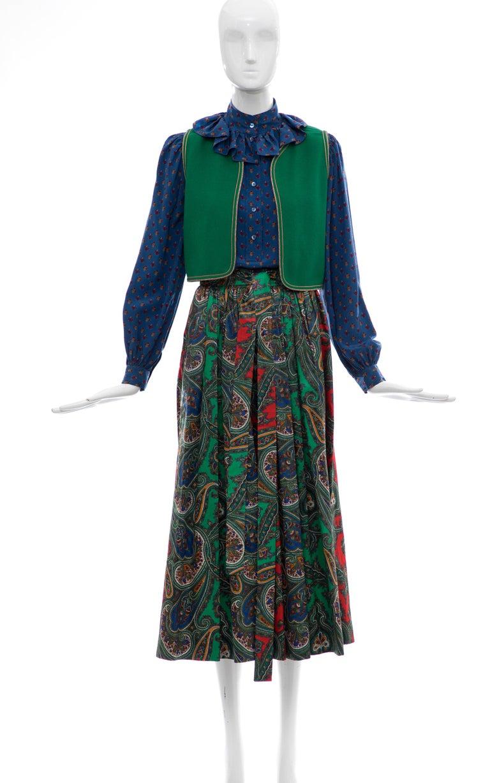 Yves Saint Laurent Rive Gauche, circa 1970s silk printed blouse, wool felted green vest, paisley print cotton sateen skirt  with one left side pocket skirt-suit.  Blouse: EU. 36, Bust 36, Length 23.5, Shoulders 14.5  Skirt: Eu. 34, Waist 22, Length