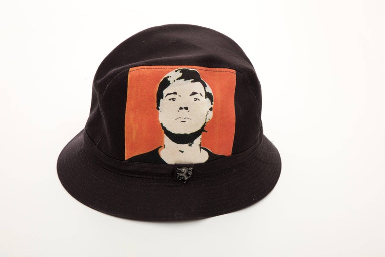 Philip Treacy, Circa 2006 black woven printed cotton Andy Warhol bucket hat lined with iconic Campbell Soup print.  Designer Size: Medium  Circumference: 23, Brim: 1.75