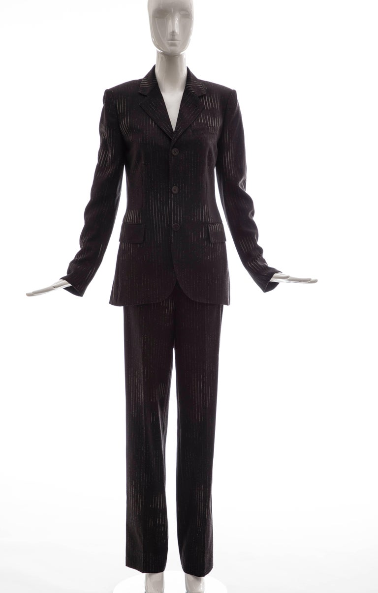 Jean Paul Gaultier, Circa 1990's 3D printed faces, wool chacoal grey pinstripe pantsuit with button front jacket, two front faux pockets, fully lined in silk with side zip pant.  IT. 42, US 8, FR 38, GB 10, D 38