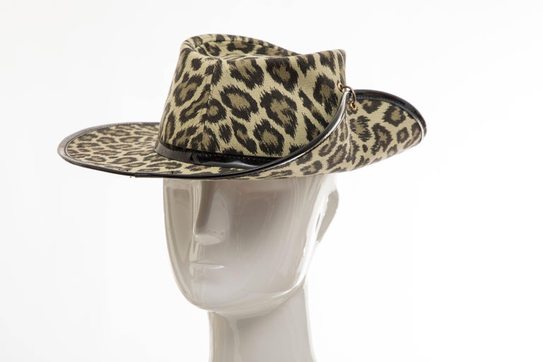 Junior Gaultier, Circa 1980's cotton leopard print hat with patent leather trim.  Circumference: 23