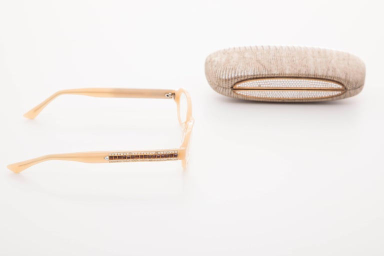 Judith Leiber readers reading glasses with crystal sides and crystal case. They have prescription lenses.