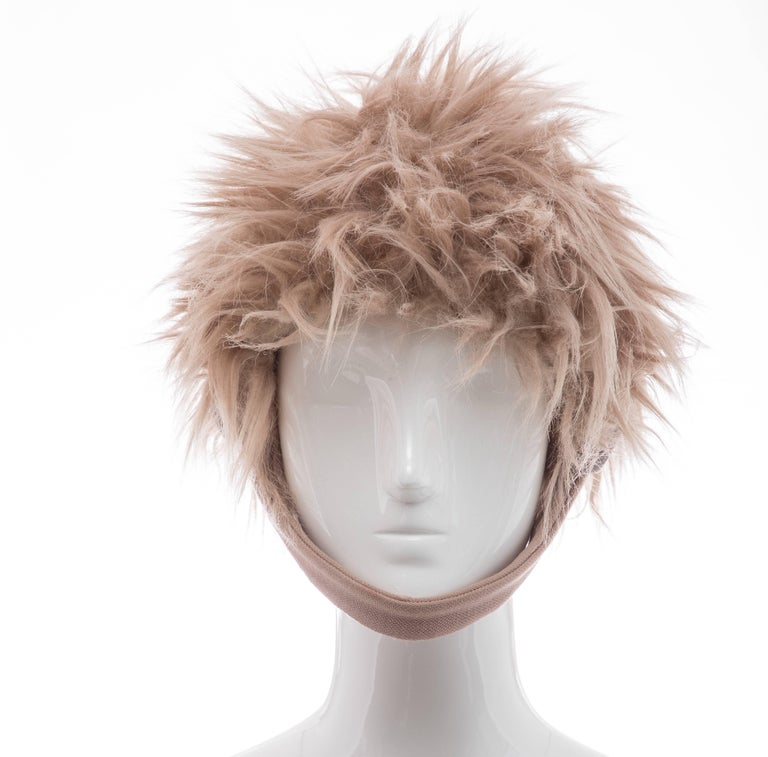 Prada, Fall 2011 faux fur hat with tonal button closures at sides.   Circumference: 20,