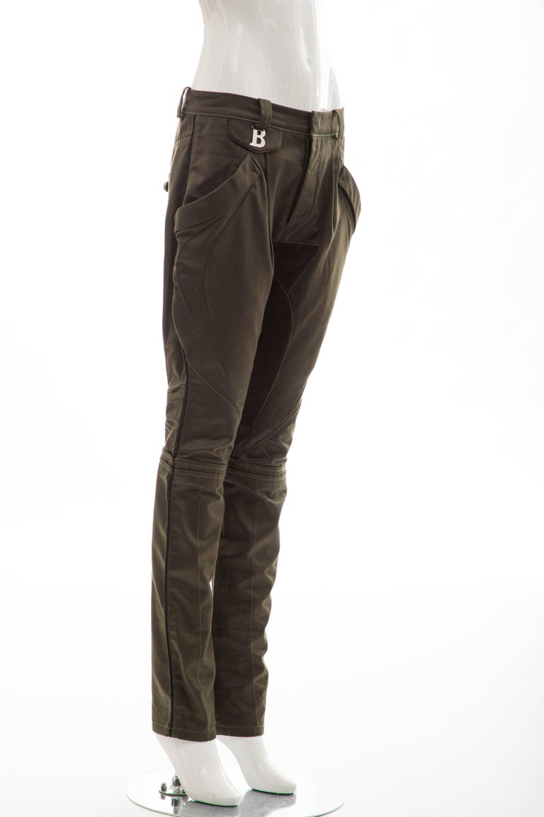 Nicolas Ghesquière For Balenciaga, Fall 2007 cotton olive green pants with suede accents at inseam, four pockets and button closures at front.  FR. 38, US. 6  Waist: 31, Hip: 38, Rise: 10.5, Inseam: 31.5, Leg Opening: 12