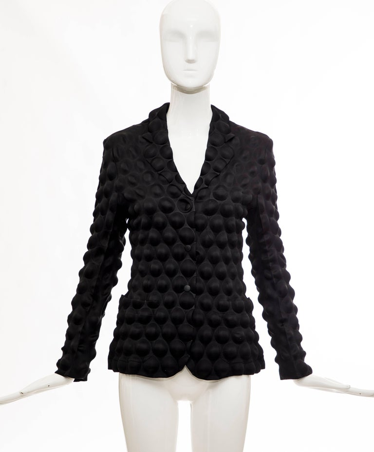 Issey Miyake, Fall 2000 black Egg Carton snap front blazer with dual patch front pockets.  Japan: 2.  Bust: 34, Waist 32, Length 24