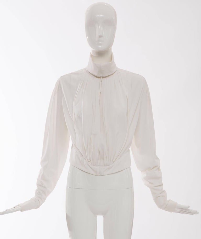 Jean Paul Gaultier, Circa 1990's white nylon, zip front pleated jacket with zip sleeves.  No Size Label  Bust 38, Waist 32, Sleeve 28, Length 18