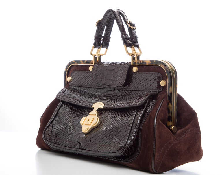 Oscar De La Renta, Fall 2007 chocolate brown suede top handle handbag with lizard front pocket, two interior pockets, cell phone holder, key ring and shoulder strap.  Width: 14, Height: 9, Depth: 6