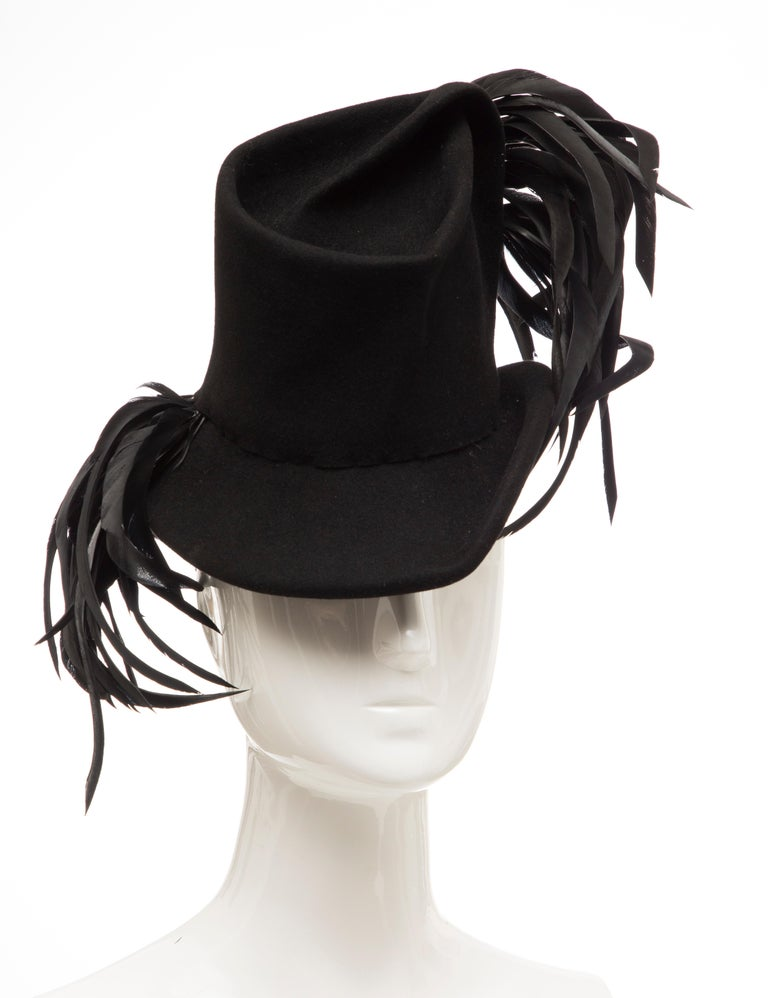 Created by Victoria, New York, Circa: 1930's black wool felt hat with appliquéd feathers.  Circumference: 16