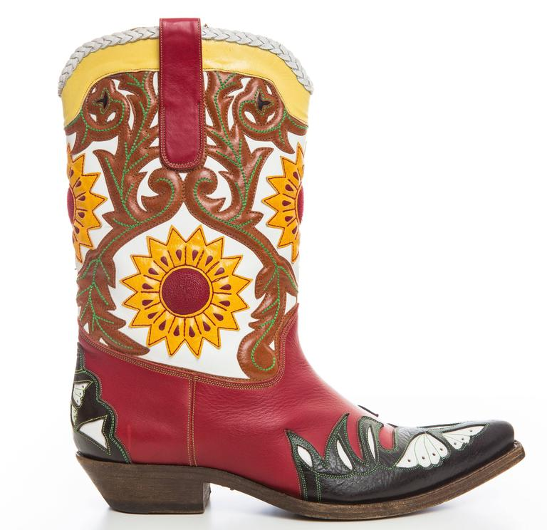 John Galliano, men's multicolor leather embroidered cowboy boots with braid trim at top, pull tabs at side and leather sole. Includes box and dust bag.